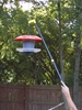 Bird house pole hanger